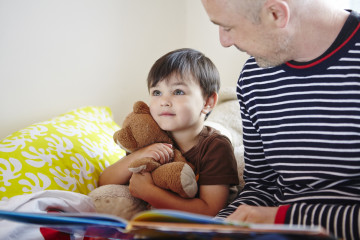 Dad reading to boy