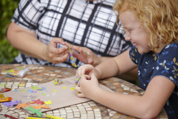 Girl playing with loom bands