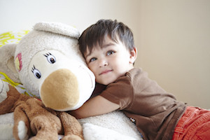 adopted boy with teddy