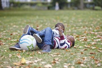 Playful wrestling in park