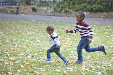 Siblings running in park