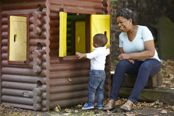 Mum and son explore playhouse