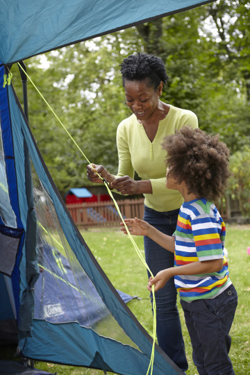 Mum and son adjust tent