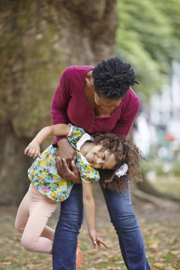 Mum gives daughter a playful lift