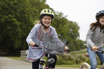 Girls cycling in the park