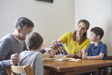Family playing together at table