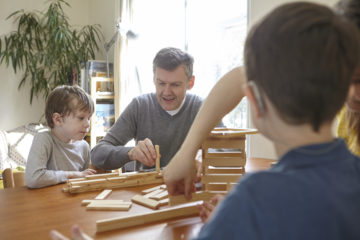 Family playing at table