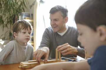 Dad and sons playing