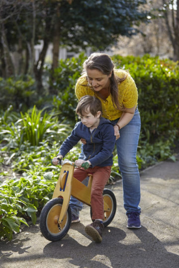 Mum helping son on bike