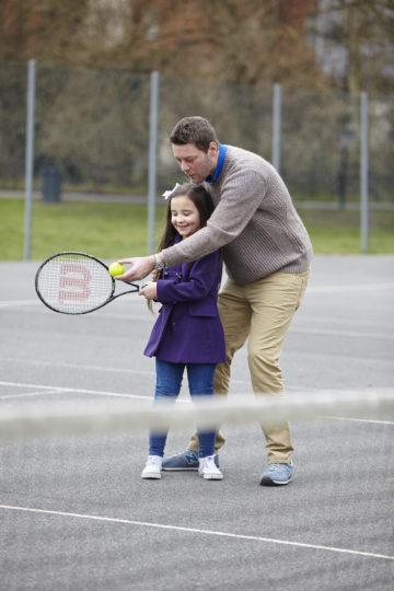 Dad coaching tennis