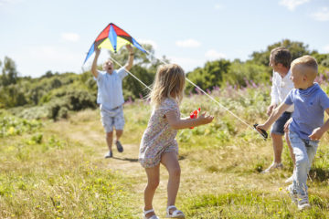 Family playing together with kite