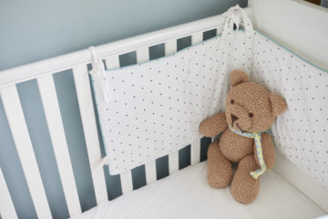 Teddy in the cot