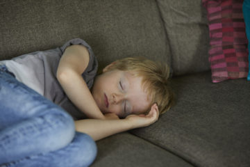 Sleeping boy on the couch
