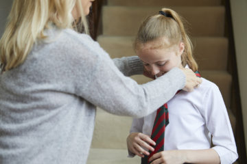 Putting on school tie